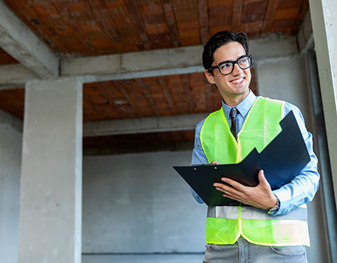 Male civil engineer with a checklist at a job site